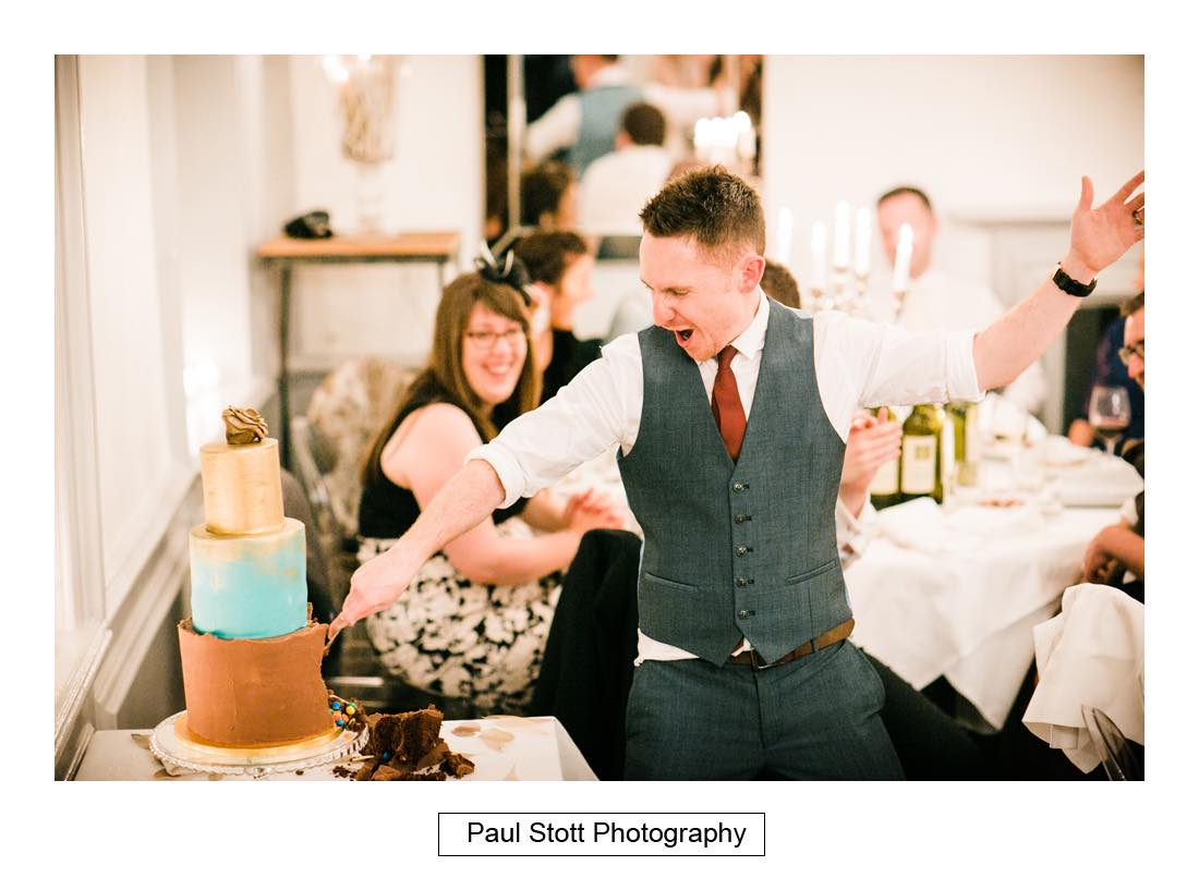 cutting cake 001 - Wedding Photography Shrewsbury Castle - Aprille and Steven