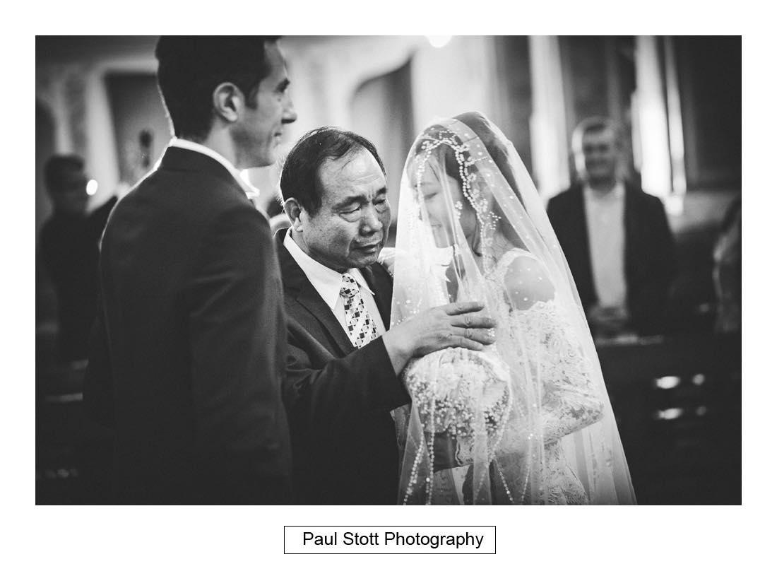 father bride lifts bridal veil - Wedding Photography Napoli - Tiffany and Carmine