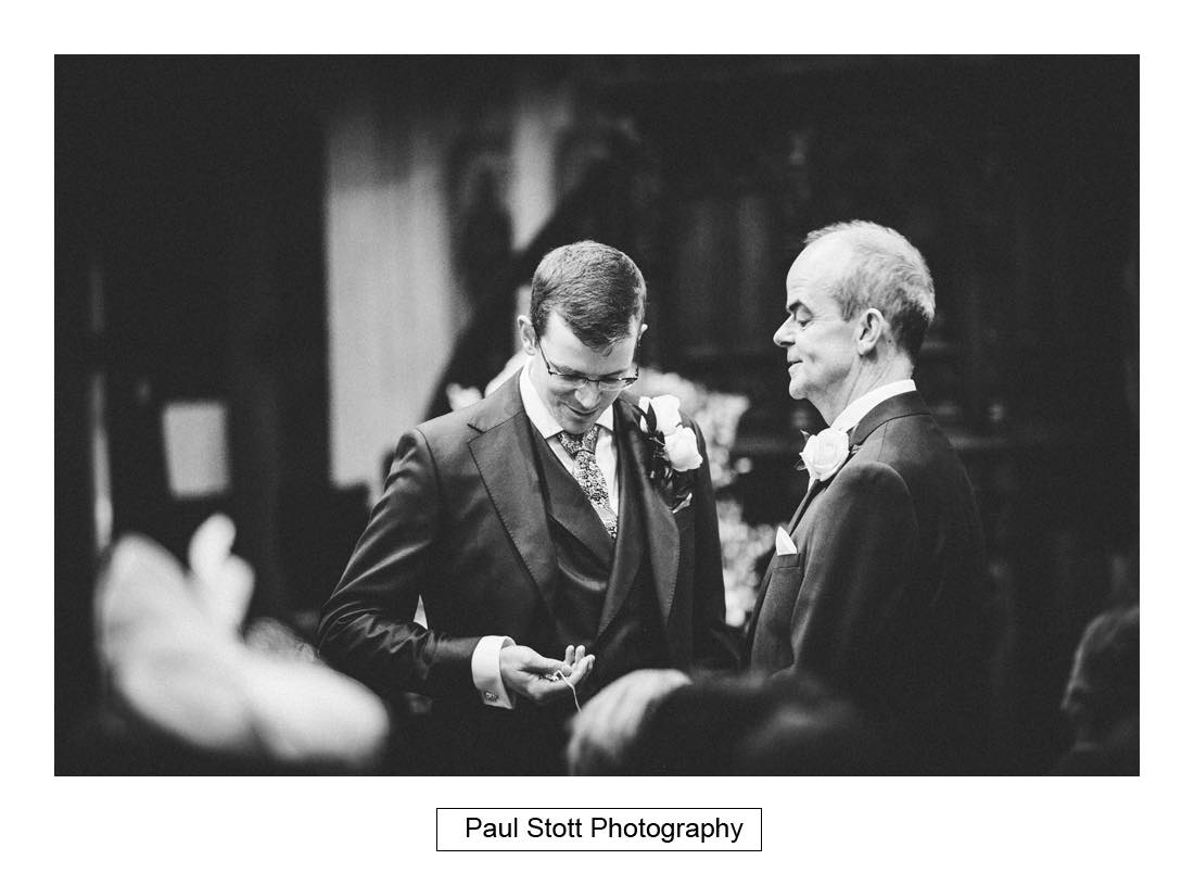 groom looking watch before ceremony - Wedding Photography Wotton House - Laura and Tim