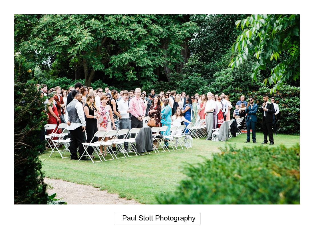 outdoor wedding ceremony capel manor 008 - Wedding Photography Capel Manor - Zaineb and Jonny