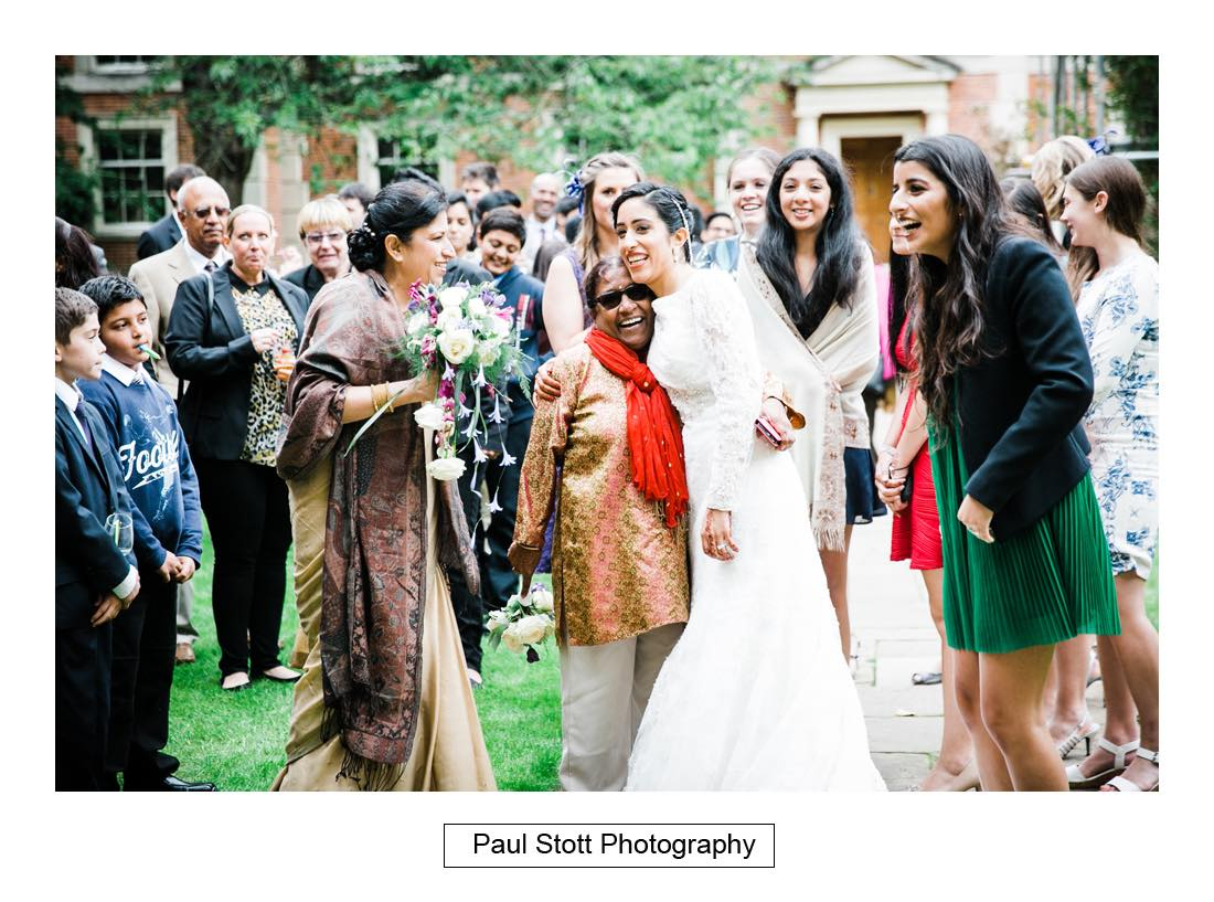 throwing the bouquet 001 - Wedding Photography Oxford Town Hall - Christian and Radhika