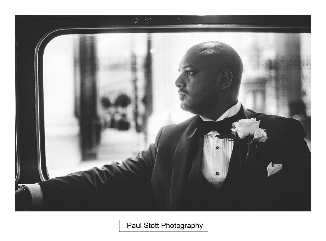 Groom on wedding bus