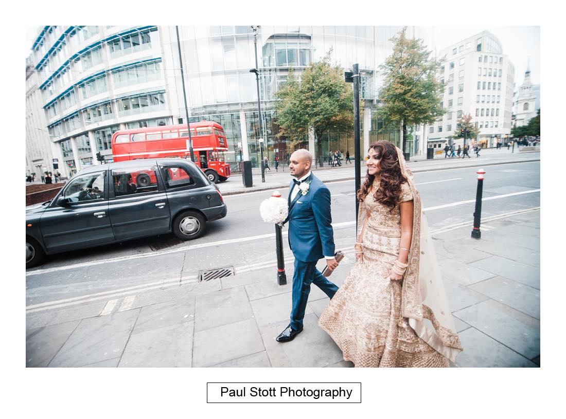 bride groom walking 003 - Wedding Photography Plaisterers Hall - Alvin and Zara