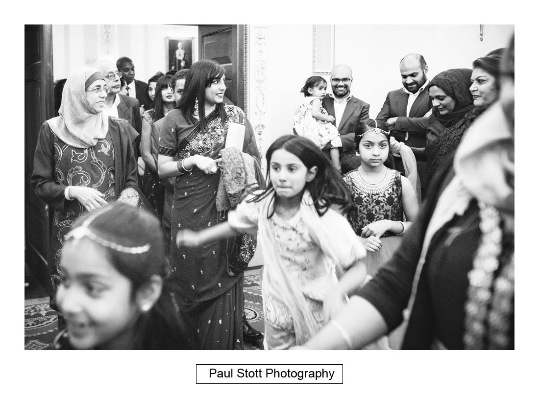 guests leaving wedding ceremony - Wedding Photography Plaisterers Hall - Alvin and Zara