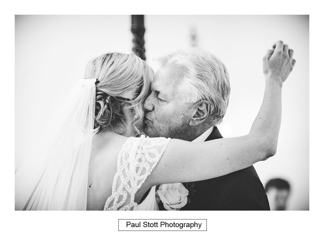 dad kisses bride 1 - Wedding Photography Botleys Mansion - Lucy and Phil