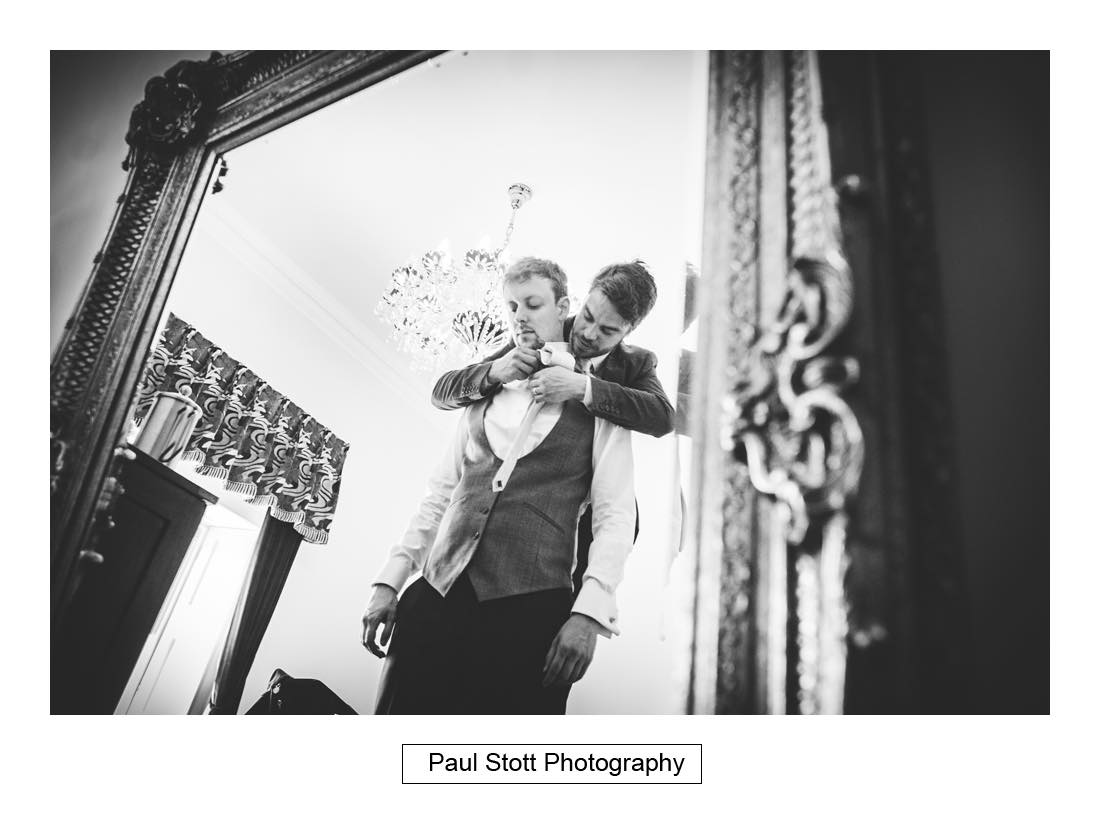 groom preparation 003 1 - Wedding Photography Botleys Mansion - Lucy and Phil