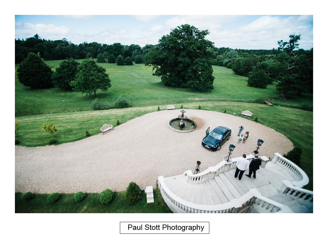 guests from bedroom window 002 1 - Wedding Photography Botleys Mansion - Lucy and Phil
