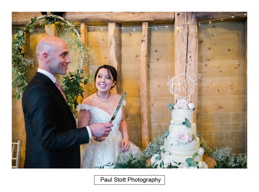 cutting the cake 001 - Wedding Photography Taylors Farm - Sylvie and Paul