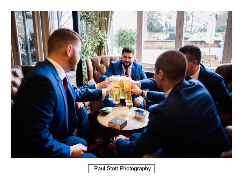 groom ushers pub 001 - Hampton Court House Wedding Photography - Phil and Vittoria