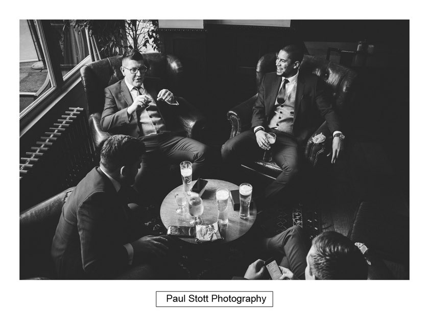 groom ushers pub 003 - Hampton Court House Wedding Photography - Phil and Vittoria