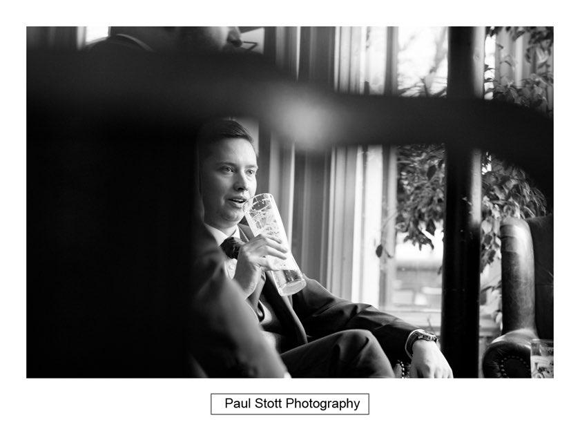 groom ushers pub 004 - Hampton Court House Wedding Photography - Phil and Vittoria