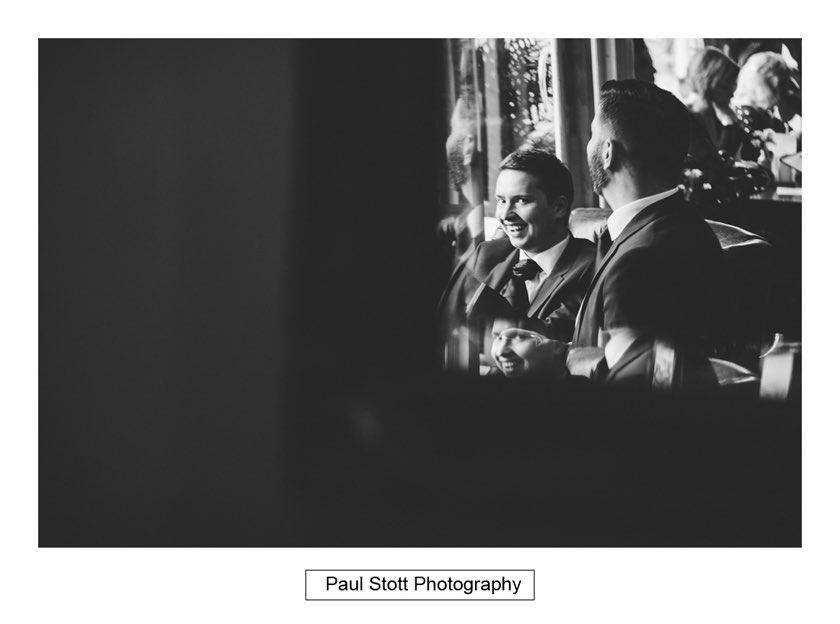 groom ushers pub 005 - Hampton Court House Wedding Photography - Phil and Vittoria