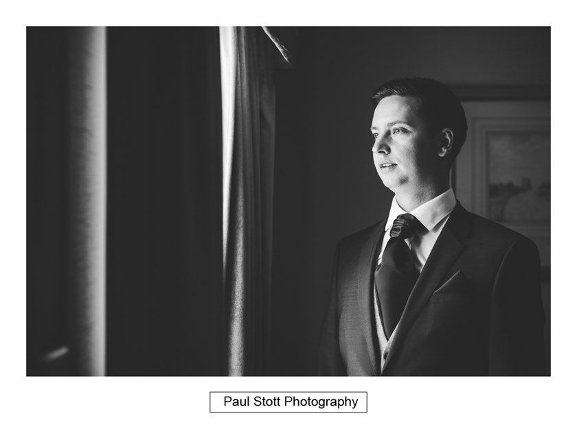 groom wedding preparation 002 - Hampton Court House Wedding Photography - Phil and Vittoria