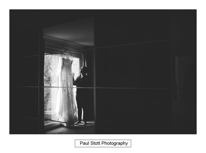 wedding dress by window - Hampton Court House Wedding Photography - Phil and Vittoria
