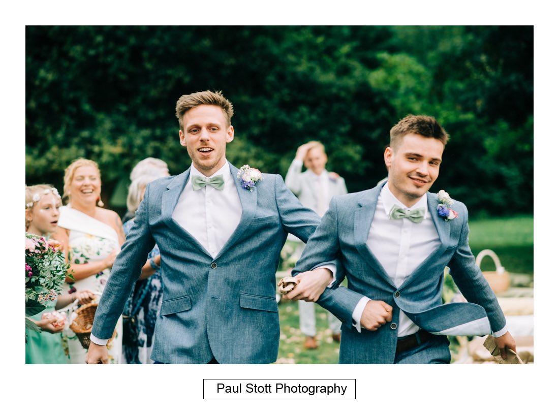092 ushers skipping - Wedding Photography Woodlands Farm  - Misha and Greg